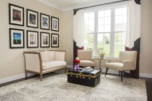 Custom drapery panels frame the window in this Living room. The pattern was created from solid fabrics, colors picked from the décor elements in this room and adjacent areas.