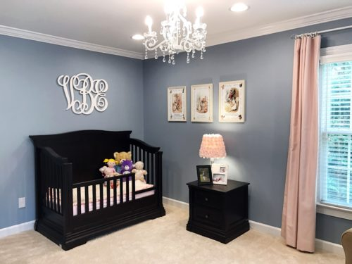Simple and elegant girl's bedroom featuring blue and pinks.