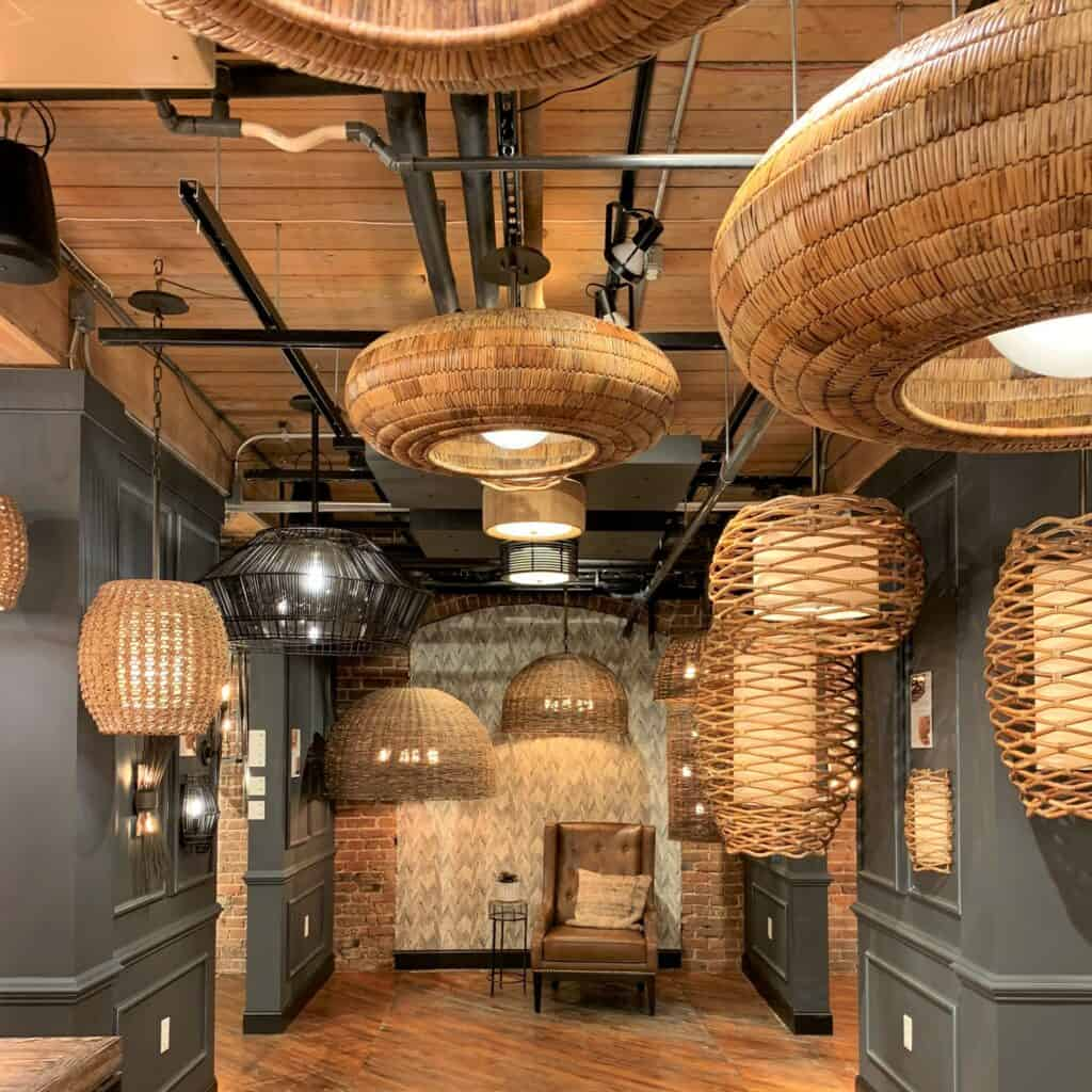 Multiple wicker chandeliers. Various sizes and weave types.
