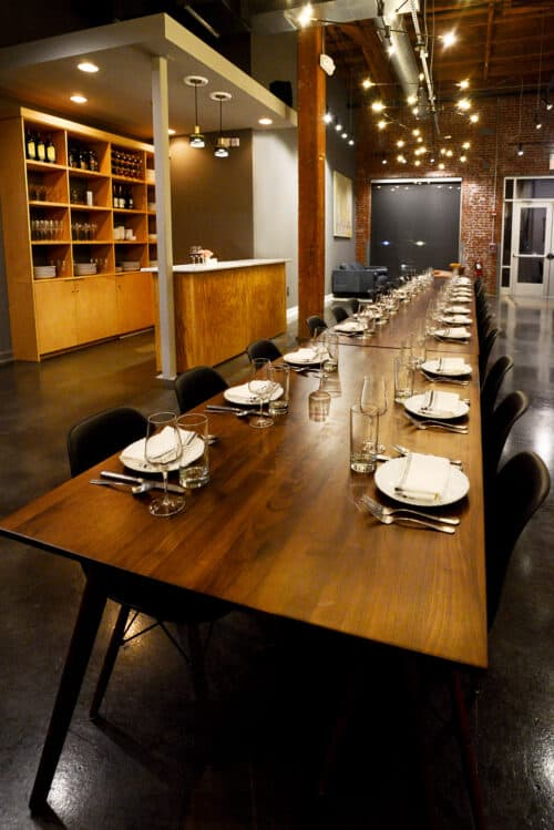 Dining table for 40 people with a bar and sitting area. Restaurant design.