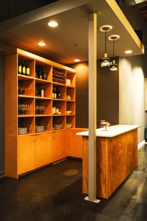 Modern bar shelving unit and marble counter top bar