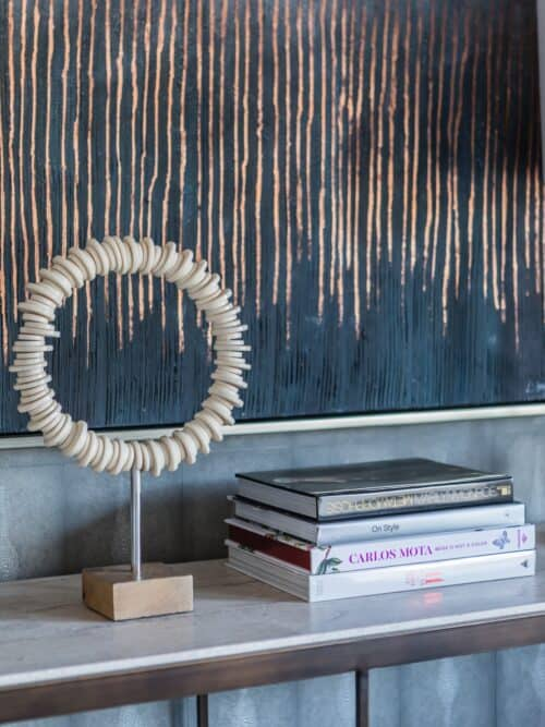 Decorated console abstract art books shagreen wallpaper