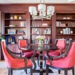 interior design study built-in shelves round table four chairs library