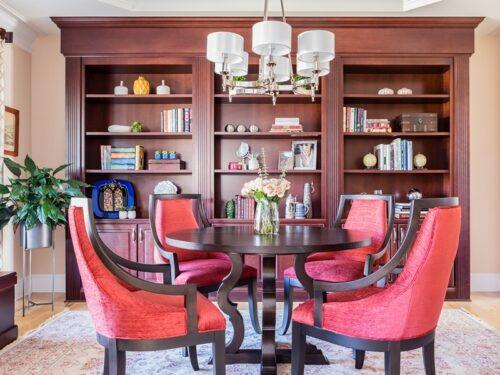 Elegant study library bookshelves red chairs