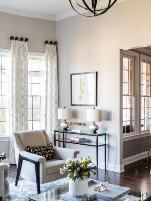 Airy family room upholstered chair window treatments