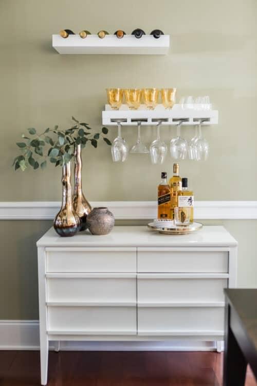 dining room bar floating shelves wine glass rack silver vase alcohol white dresser