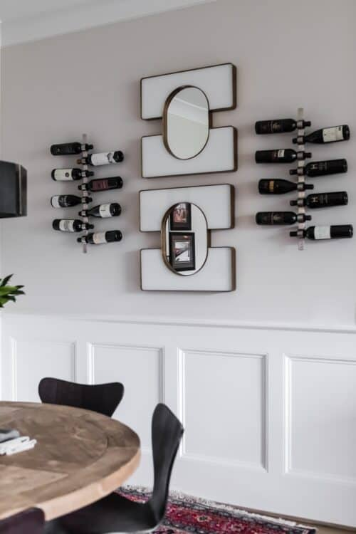 breakfast nook distressed wood table wall-mounted wine rack unique mirrors