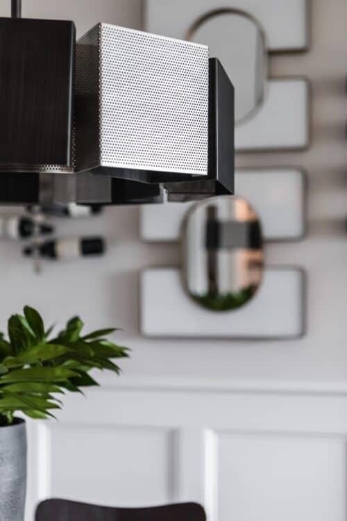 modern gray perforated metal light fixture breakfast nook mirrors