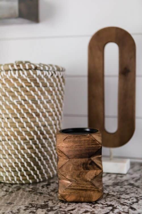 decor accessories brown wood pencil holder wooden letter O wicker basket marble counter