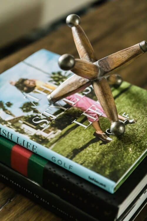 stack of books wooden toy golf