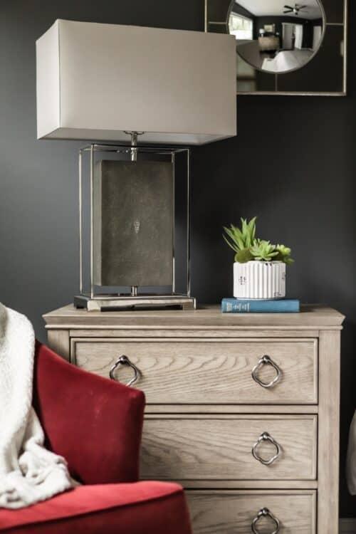 master bedroom red velvet armchair nightstand lamp succulents LK Design