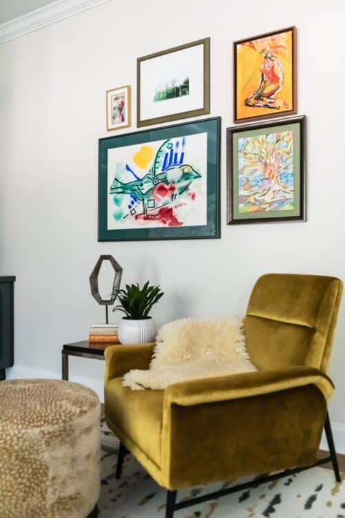 reading nook yellow velvet chair ottoman sheepskin potted plant art collection interior design LK Design