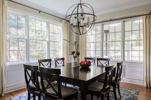 interior design dining room round chandelier draperies curtains vase eucalyptus branches